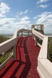The boardwalk leading to the beach on a cloudy day Royalty Free Stock Photo