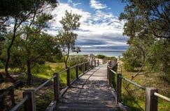 Boardwalk leading to beautiful Australian beach Stock Images