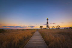 Boardwalk leading to Bodie Island Light. A beautiful sunset at Bodie Island Lighthouse in Nags Head Royalty Free Stock Photos