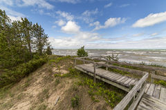 Boardwalk Leading to a Lake Huron Beach - Ontario, Canada Stock Images