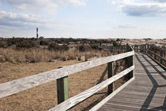 Boardwalk Leading to the Lighthouse. Fire Island Lighthouse located at Fire Island National Seashore, Long Island, New York Royalty Free Stock Photo
