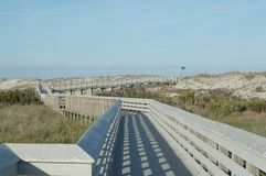 The boardwalk leading to the ocean royalty free stock images