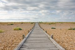 Boardwalk at Lydd Beach, Dungeness, Kent, UK royalty free stock photography