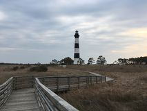 Boardwalk through marsh to the Bodie Lighthouse in Nags Head, North Carolina royalty free stock photo