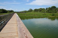 Boardwalk Green Cay Wetlands. A boardwalk with metal guard rails leads to the rest area at Green Cay Wetlands Nature Preserve, Boynton Beach, Florida stock photography