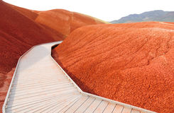 Boardwalk through mounds of red earth Royalty Free Stock Images