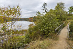Boardwalk Next to a Lake in Autumn - Ontario, Canada. Trail with a Boardwalk Next to a Lake in Autumn - Algonquin Provincial Park, Ontario, Canada stock photography