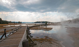 Boardwalk next to Tangled Creek and Black Warrior Springs leading into Hot Lake in Yellowstone National park in Wyoming USA Royalty Free Stock Photography
