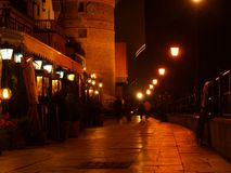 Boardwalk at night in Gdansk city. Night scene of old town and boardwalk with historic elevator; Gdansk, Poland stock photography