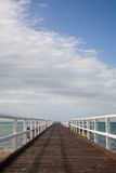 Boardwalk into the ocean Royalty Free Stock Image