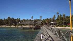 Boardwalk in ocean in front of tropical island - Siargao Island, Philippines stock footage