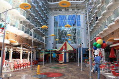 Boardwalk onboard oasis of the seas. Outside deck with carousel for kids, dining venues, shops on board Royal Caribbean owned cruise ship Oasis of the Seas Stock Photos