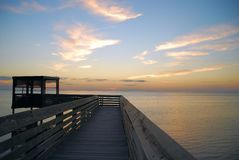 Boardwalk over Laguna Madre. Quiet sunset lights the boardwalk and bird-blind overlooking the Laguna Madre, behind the South Padre Island Convention Center stock image
