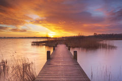 Boardwalk over water at sunrise in The Netherlands Royalty Free Stock Images