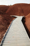 Boardwalk on painted hill stock photography