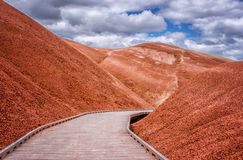 The Boardwalk. The Painted Hills are in Northwest United States, John Day Fossil Beds National Monument in Oregon. This is the Boardwalk at The Painted Cove stock images