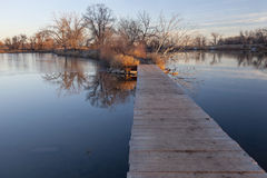 Boardwalk pathway over lake Stock Photo