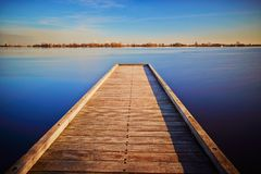 Boardwalk, A pier that goes into the water.  Stock Photography