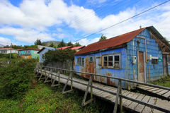 Boardwalk, Puerto Eden in Wellington Islands, fiords of southern Chile Royalty Free Stock Photos