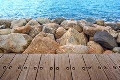 Boardwalk and Rocks At Seashore Royalty Free Stock Photo