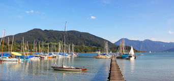 Boardwalk and sailboats, alpine landscape upper bavaria Royalty Free Stock Images