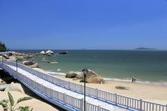 Boardwalk on the sandy beach Stock Photo