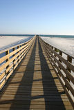 Boardwalk into the sea Stock Image