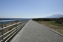 Boardwalk at the seashore outside the village Lapta in the North Stock Photography