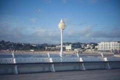 Boardwalk in seaside town Stock Images