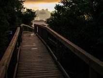Boardwalk on St. John, Virgin Islands, Sunrise Island View. A sunrise view at the ocean and an island from a boardwalk on the island of St. John in the Virgin Royalty Free Stock Photography