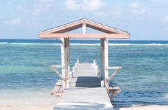 Boardwalk structure leads out to the ocean, calm and relaxing view royalty free stock photo