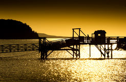 Boardwalk at sunrise. Leading to tall wind sailing ship in Bar Harbor Stock Photos