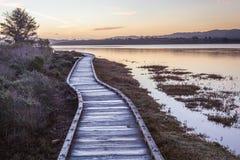 A boardwalk with sunrise/ sunset scene. Royalty Free Stock Photos