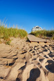Boardwalk to the beach. The end of a boardwalk onto a Maine beach, early morning Stock Images