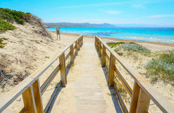 Boardwalk to the beach in Capo Testa Royalty Free Stock Photo