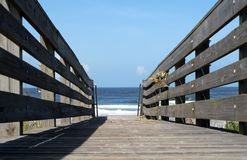 Boardwalk to ocean Stock Photos