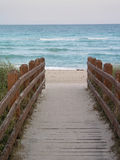 Boardwalk to the Ocean. Walkway to the beach and water Royalty Free Stock Images