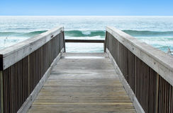 Boardwalk to ocean waves. View of the ocean waves from the boardwalk to the beach Royalty Free Stock Photos