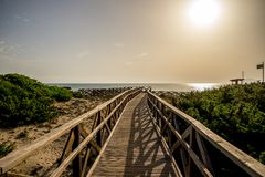 A boardwalk to Playa de Muro beach in Can Picafort, Alcudia bay. Majorca Stock Image