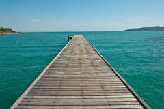 Boardwalk to the sea and blue sky Stock Photo