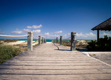 Boardwalk turks and caicos. Walkway to grace bay beach in Turks and Caicos Royalty Free Stock Photos