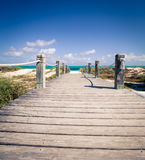 Boardwalk turks and caicos. Walkway to grace bay beach in Turks and Caicos Stock Photo