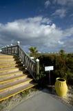 Boardwalk with yellow urn Stock Photo