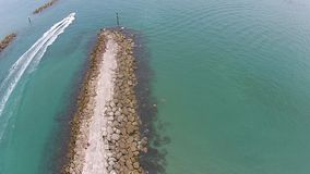 Boaring inlet in Florida aerial stock video footage