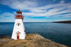 Boars Head Lighthouse Bay of Fundy NS Canada. Bay of Fundy coastline and Boar`s Head Lighthouse near Tiverton on Long Island, Nova Scotia, NS, Canada royalty free stock photography