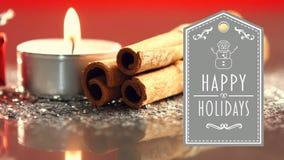 Boas festas texto com o presente, iluminado velas e varas de canela filme