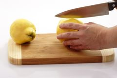 Boasting. Bosting quinces on a kitchen board Stock Images