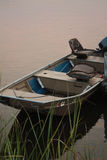 Boat. Small fishing boat docked on the river Royalty Free Stock Photography