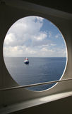 Boat. View of a boat through an another bigger boat side opening Royalty Free Stock Photography