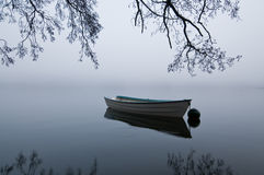 Boat. In foggy weather at a lake Royalty Free Stock Photo